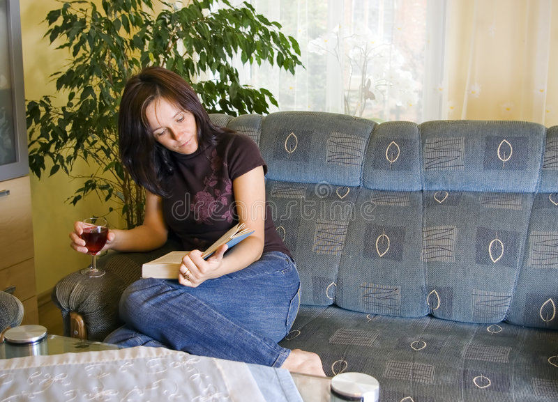 Woman reading at home stock photo