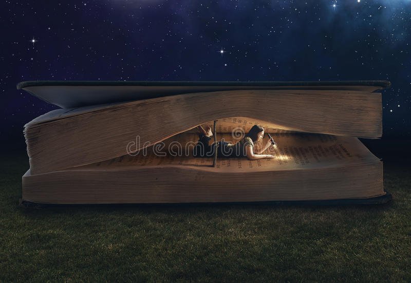 Woman reading inside a huge book. At night
