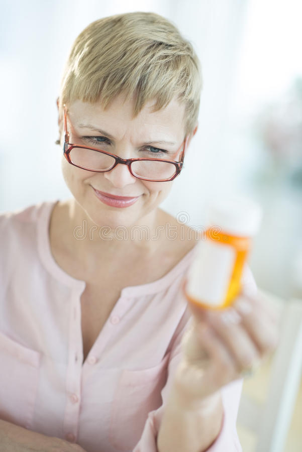 Download Woman Reading Instructions On Pill Bottle Stock Image - Image: 33119931