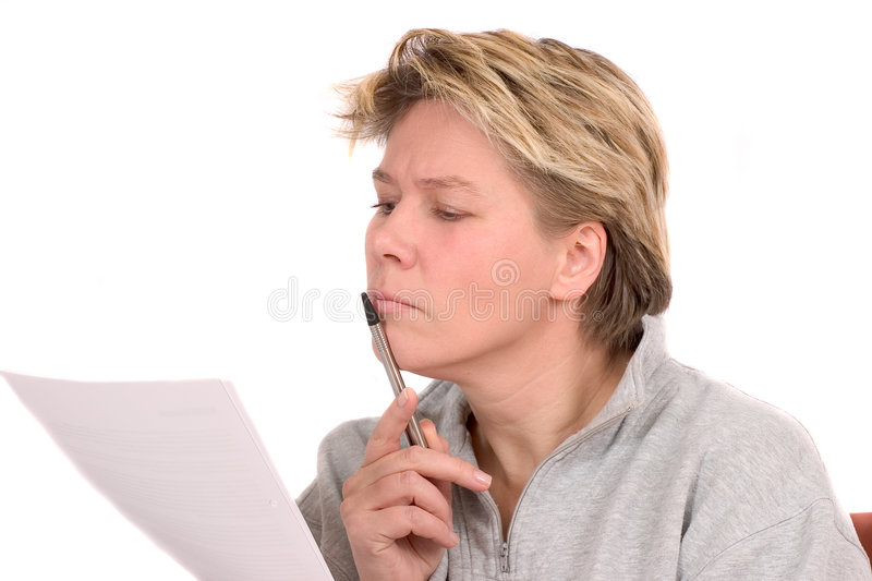 Woman reading a legal document stock images