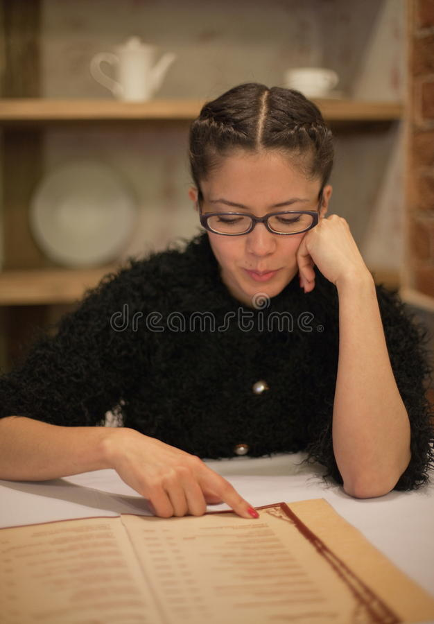 Free Woman Reading Menu Stock Photo - 19501070
