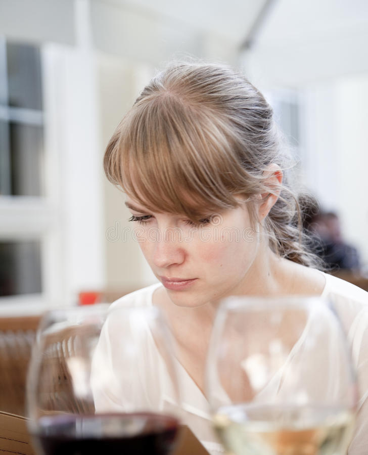Woman reading the menu stock photo