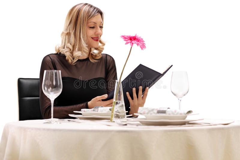Woman reading the menu royalty free stock photos