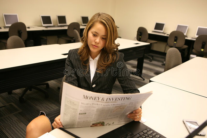 Woman Reading Newspaper stock photo