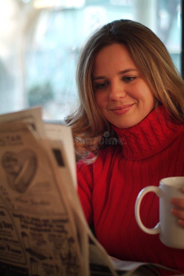 Woman reading newspaper royalty free stock photo