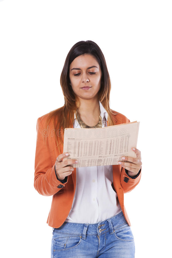 Woman reading the newspaper stock image