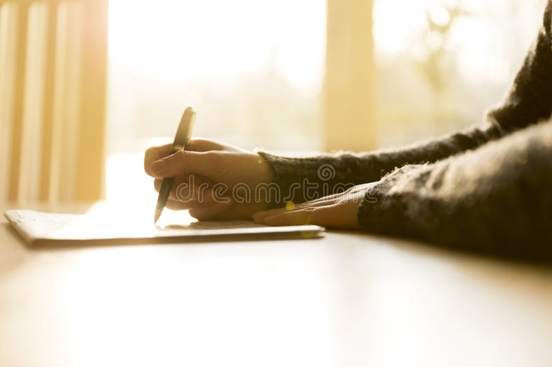 Woman reading newspaper and searching advertisements for emplyment, job, real estate, car sale information stock photos
