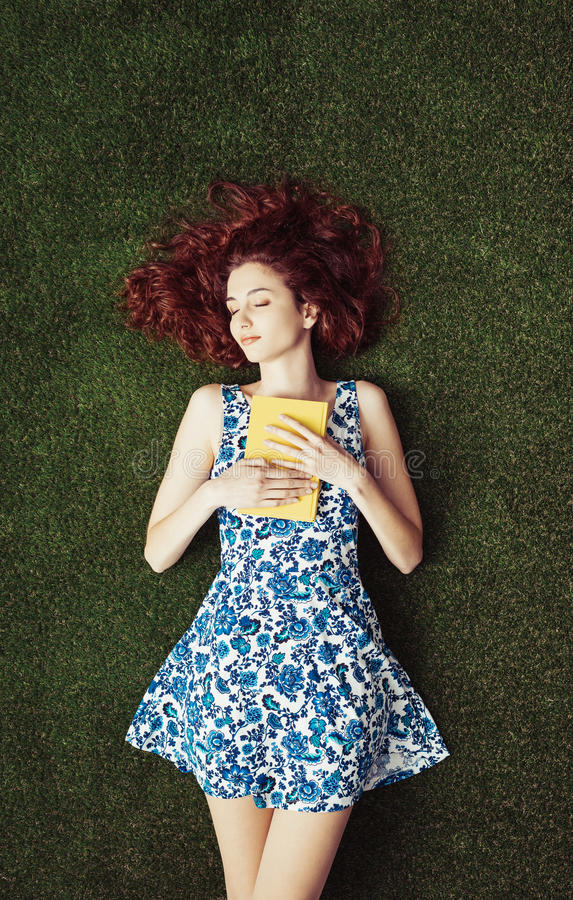 Woman reading at the park stock image