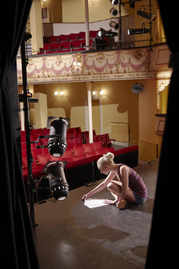 Woman Reading Script On Stage royalty free stock photo