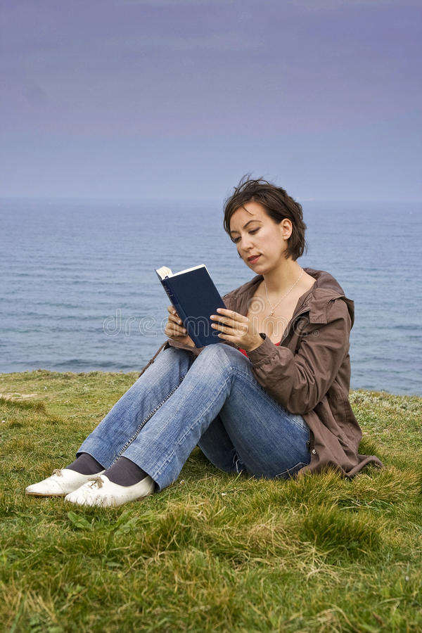 Woman Reading By The Sea Royalty Free Stock Image