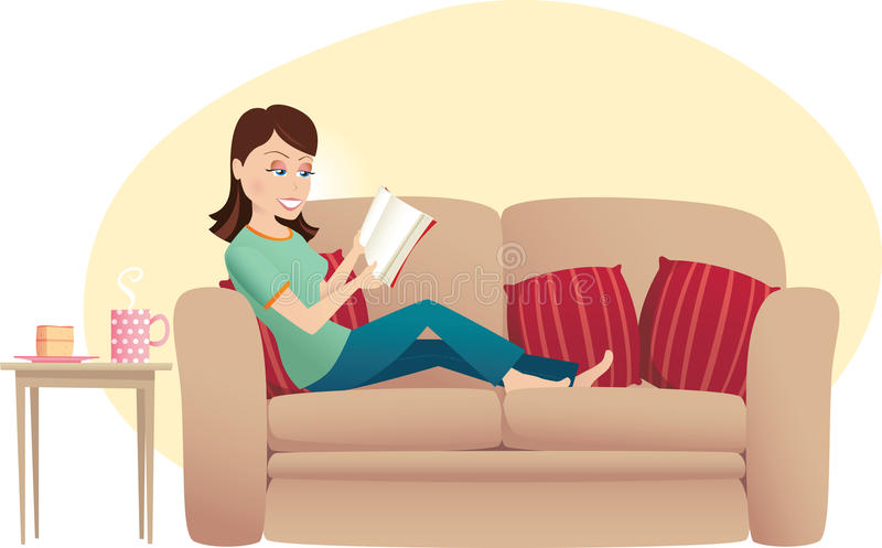 Woman reading on sofa stock image
