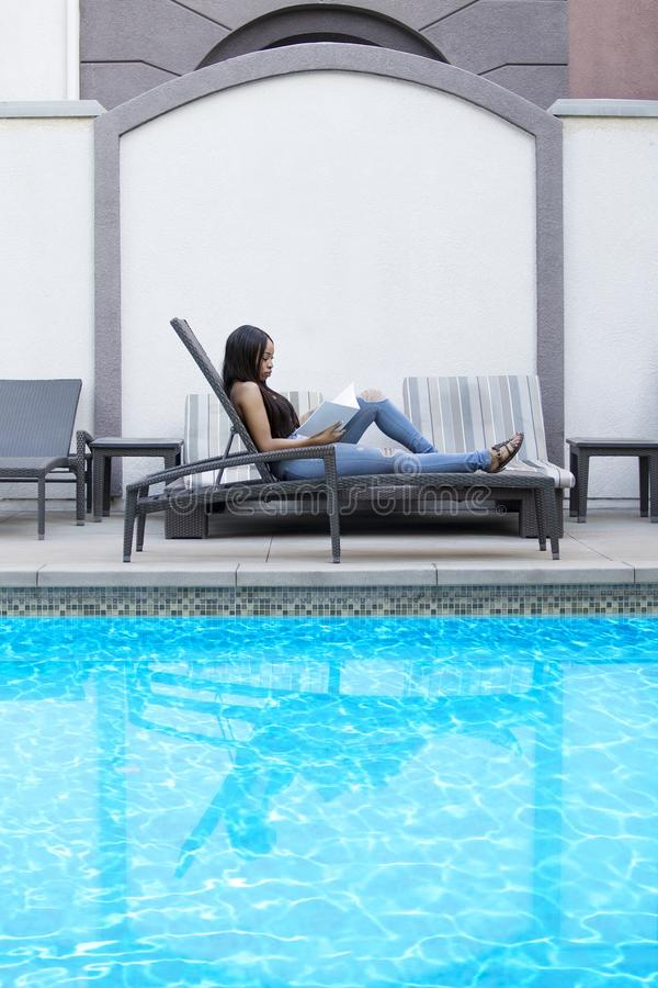 Woman Reading Spa or Hotel Brochure royalty free stock image