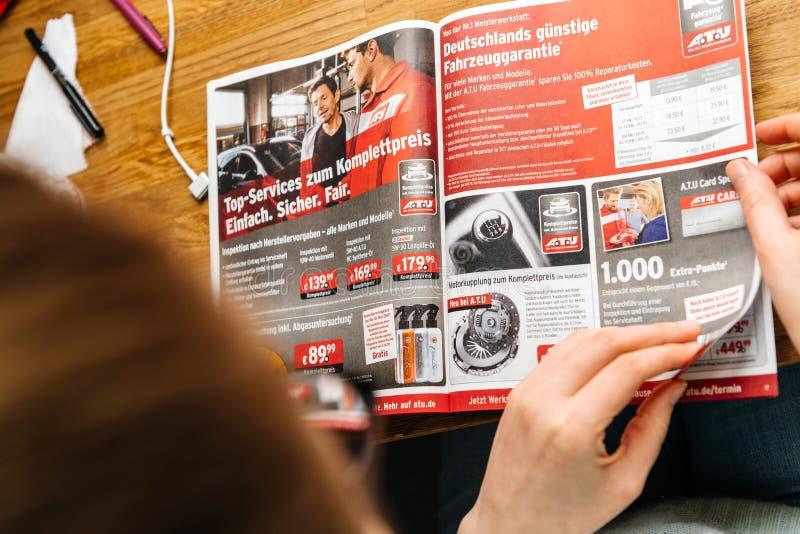 Woman Reading A.T.U Auto-Teile-Unger German Automotive Services ...