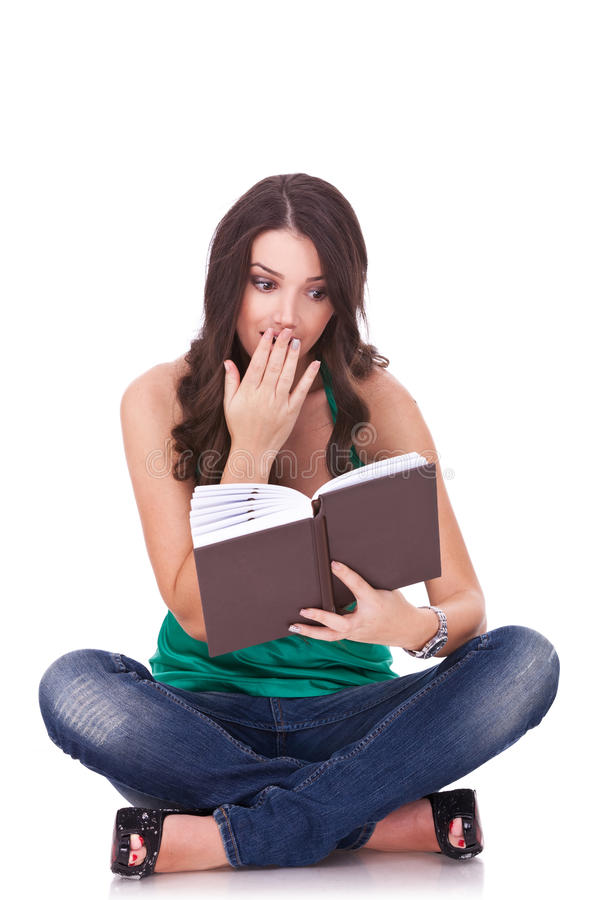 Woman reading a thriller book royalty free stock photo