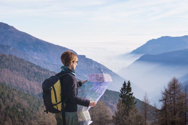Woman reading trekking map on the Alps stock photo
