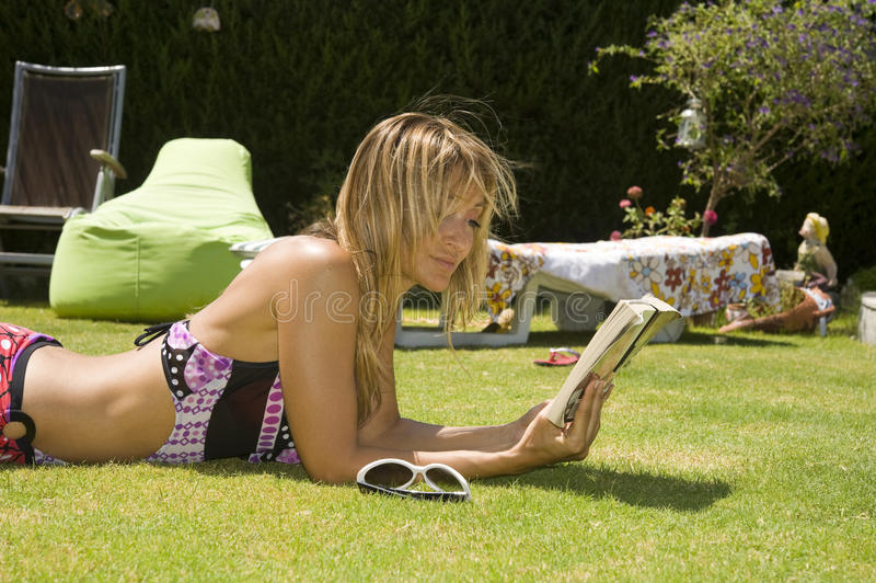 Woman reads the book. stock photography