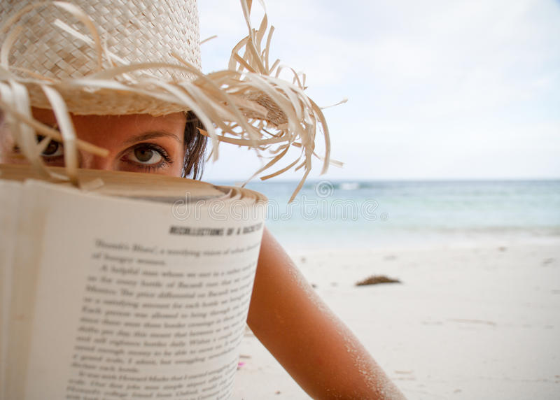 Download Woman Reads A Book On Beach Stock Photo - Image: 26735804