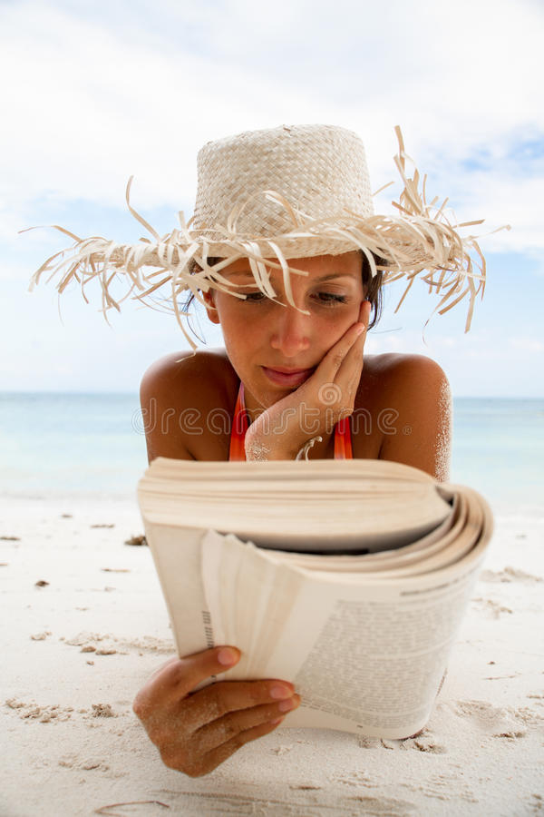 Woman Reads A Book On Beach Royalty Free Stock Photography