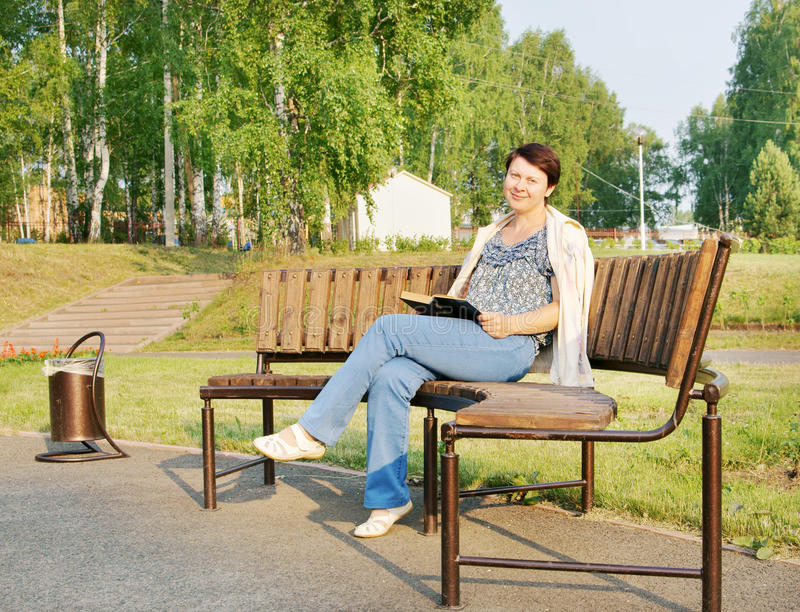 Download Woman Reads A Book On A Bench Stock Image - Image of face, adult: 25645915