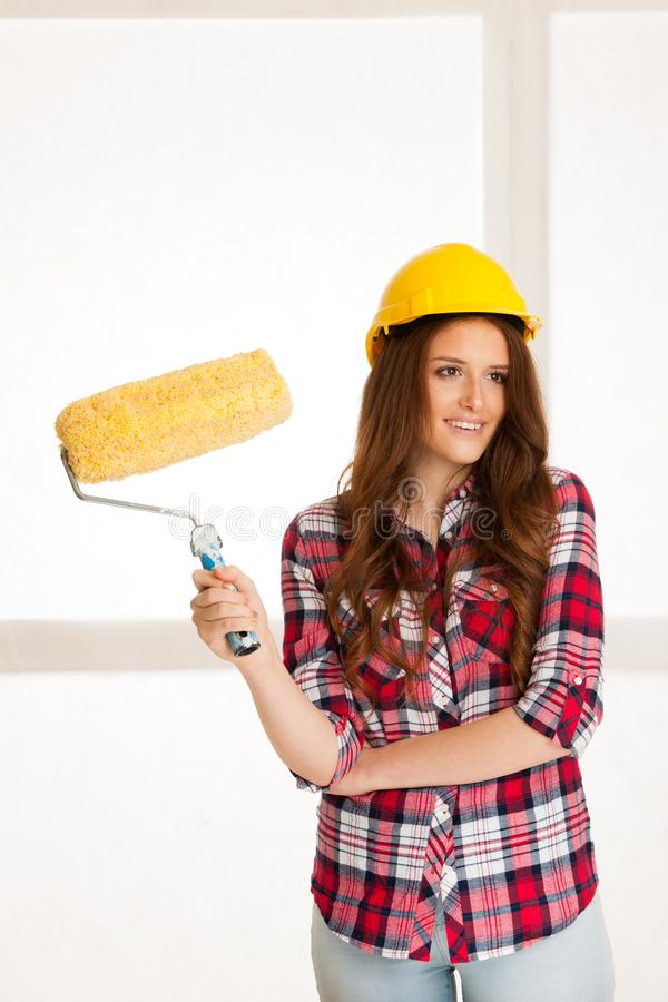 Woman ready to paint walls stock photos