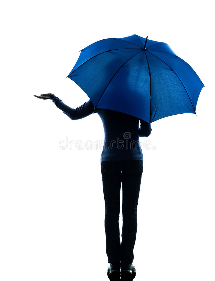 Woman rear view holding umbrella palm gesture stock photo