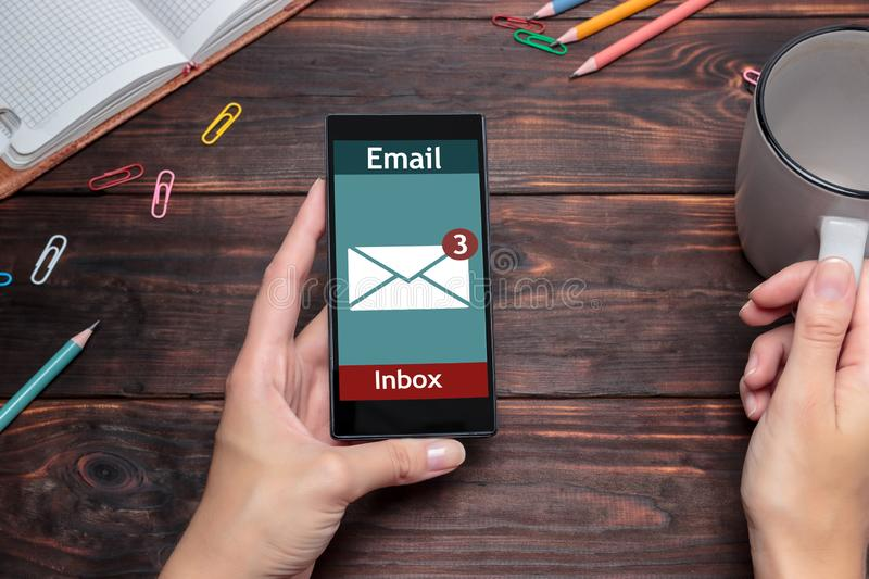 The woman received an e-mail online on a mobile phone. Message online icon stock photo