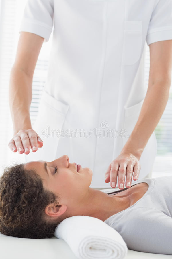Woman receiving alternative therapy stock images