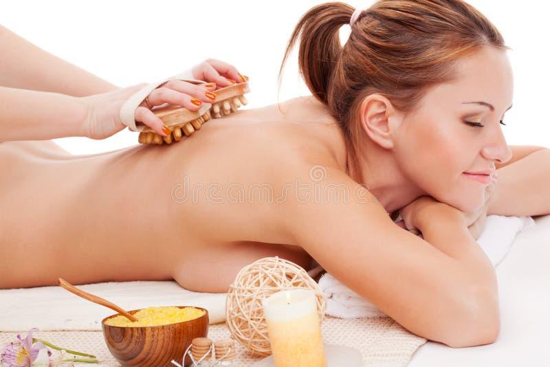 Woman receiving back massage stock photos