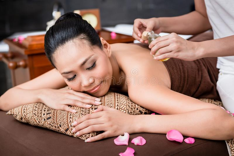 Woman receiving back massage royalty free stock image