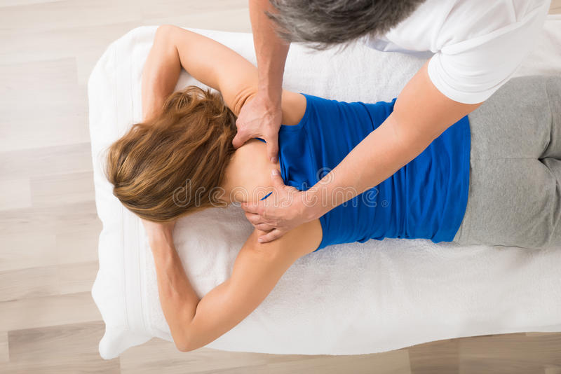 Woman Receiving Body Massage. High Angle View Of Woman Receiving Body Massage At Spa stock photo