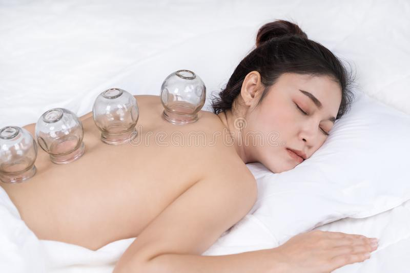 Woman receiving cupping treatment on back royalty free stock photo