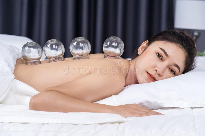 Woman receiving cupping treatment on back royalty free stock images