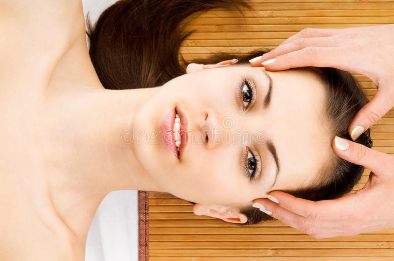 Woman receiving facial massage stock images