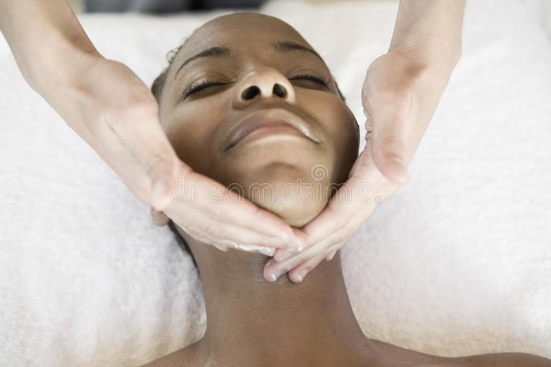 Woman Receiving Facial Massage At Spa royalty free stock image