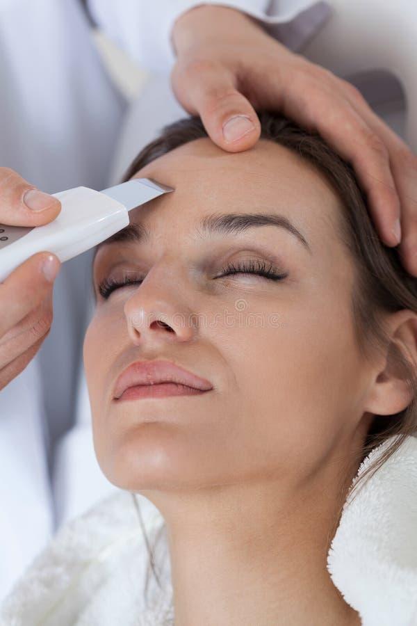 Woman receiving facial rejuvenating treatments royalty free stock images