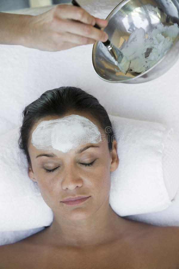 Woman Receiving Facial Treatment In The Spa royalty free stock photos