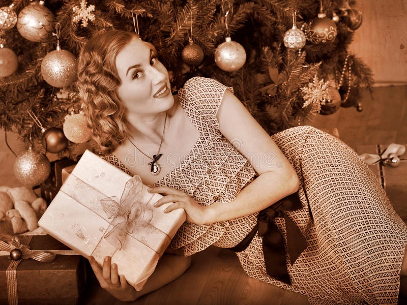 Woman receiving gifts. Black and white retro. stock photography