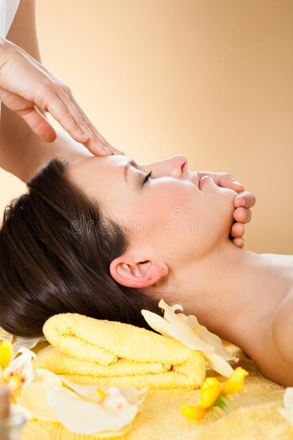 Woman receiving head massage in spa royalty free stock photography