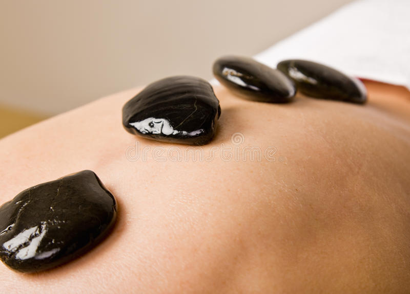 Woman Receiving Hot Stone Therapy Massage Royalty Free Stock Image