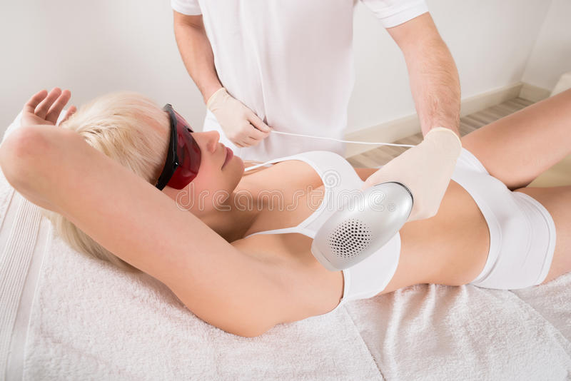 Woman Receiving Laser Epilation Treatment In Spa royalty free stock photography