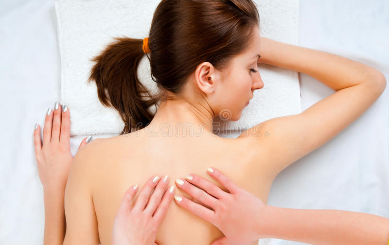 Woman receiving massage in spa salon royalty free stock photos