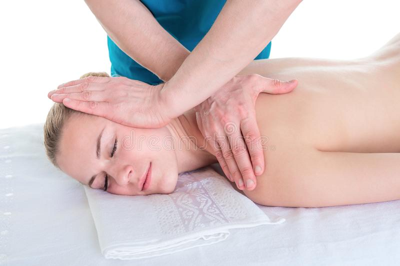 Woman receiving neck massage in medical office stock photography