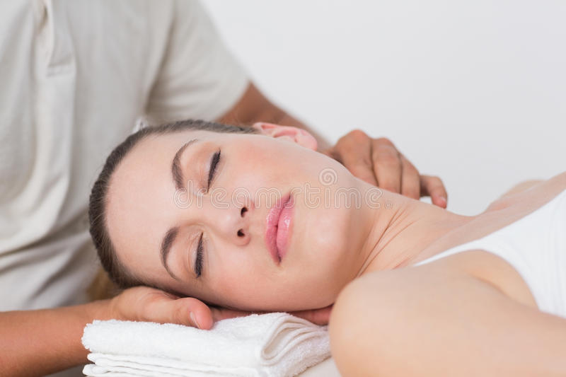 Woman receiving neck massage. In medical office royalty free stock photos