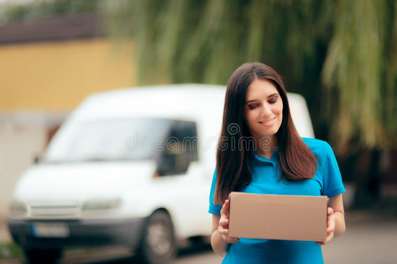 Woman Receiving a Package with Free Shipping Courier Delivery. Happy customer receiving internet ordered goods with fast shipment stock photo
