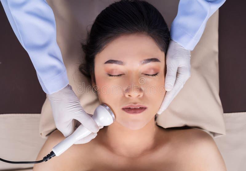Woman receiving ultrasound facial beauty treatment skin care royalty free stock photos