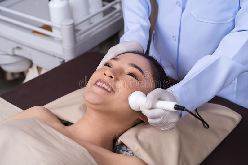 Woman receiving ultrasound facial beauty treatment skin care royalty free stock photography