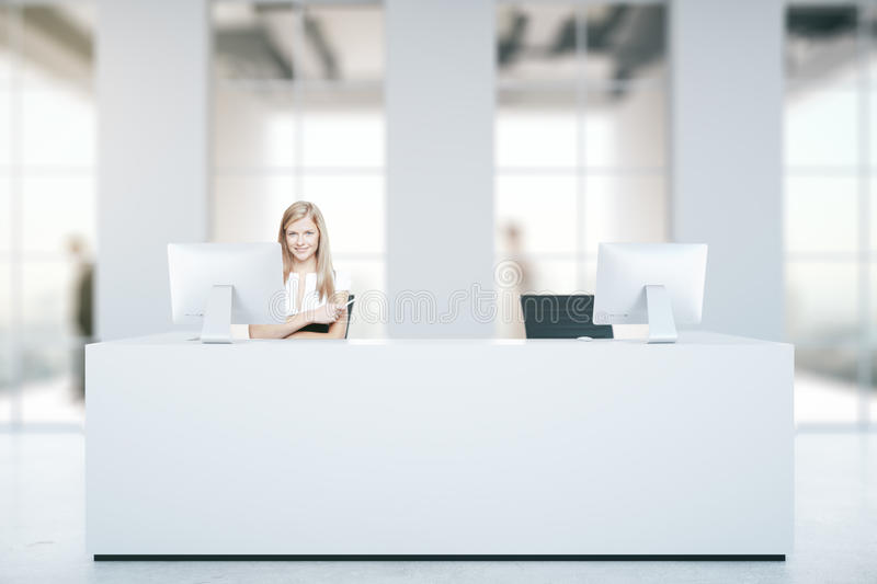 Woman at reception desk royalty free stock photo