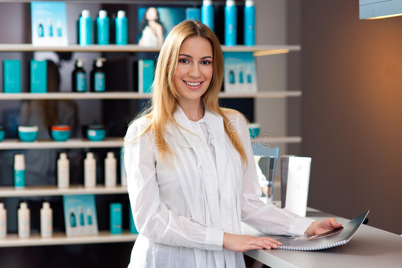 Woman in reception desk stock image