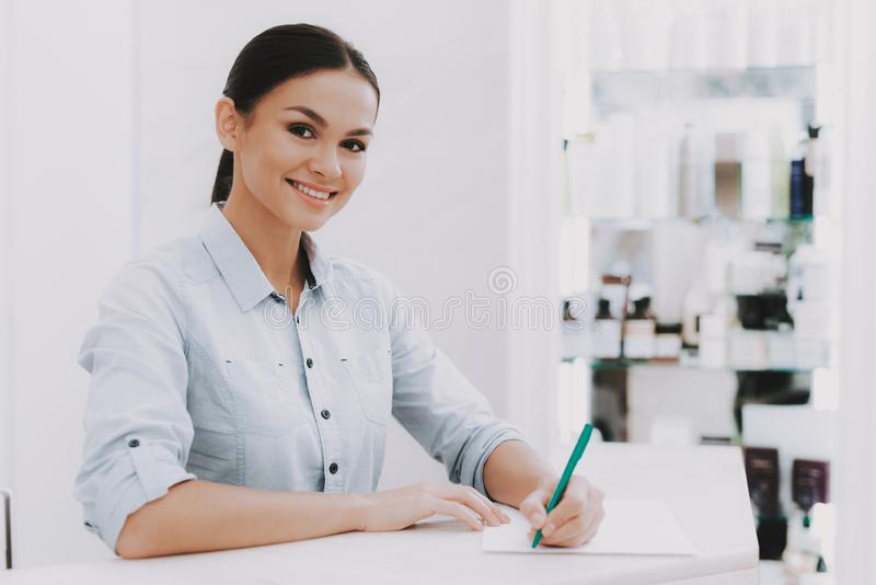 Woman Receptionist in Workplace in Beauty Salon. royalty free stock photos