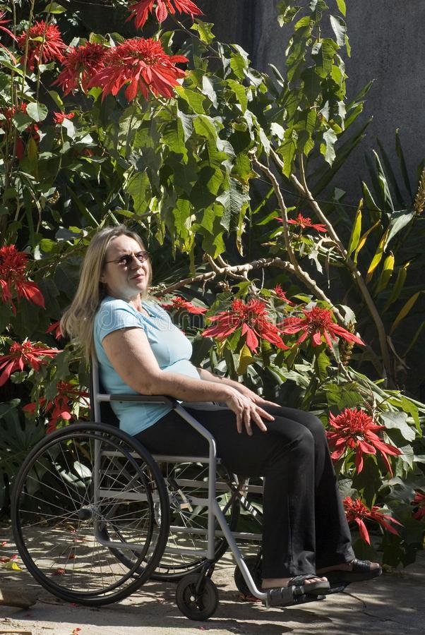 Woman Reclines in Wheelchair - Vertical stock images